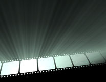 Filmstrip movie glowing light flare. Strip of video film negative projected with spotlight halo flares. Free space and emptied frame for message Royalty Free Stock Photography
