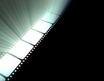 Filmstrip movie glowing light flare Stock Images