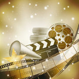 Filmstrip and stars. Cinema background with retro filmstrip, clapper and stars Royalty Free Stock Photo