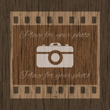 Filmstrip template with photo camera on wooden background Stock Image