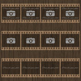 Filmstrip template with photo camera on wooden background Royalty Free Stock Images