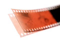 Filmstrip on white. Negative filmstrip on white background stock photography