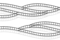 Filmstrips. The picture shows crossing filmstrips isolated on white background Royalty Free Stock Photography