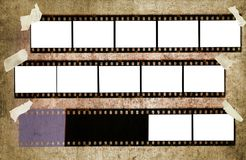 Filmstrips. Vintage filmstrips,with blank picture frames free copy space,on grungy background Royalty Free Stock Photos