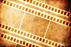 Filmstrips. Filmstrip pattern_on grungy, burned background -illustration Royalty Free Stock Image