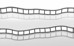 Filmstrips. The picture shows two empty Filmstrips reflected on ground Stock Photo