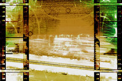 Filmstrips abstract grunge. Brown and green and white grunge background is from a photograph, then layered with filmstrips border Stock Photo