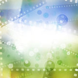 Filmstrips. Blue and green background Royalty Free Stock Photo