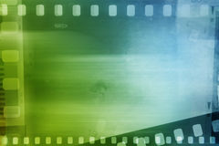 Filmstrips. Blue and green background Royalty Free Stock Photography