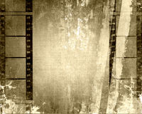 Filmstrips Grunge. Vintage aged sepia brown grunge texture with filmstrips border Stock Photos
