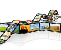 Filmstrips. Photos on filmstrips. Isolated over white Royalty Free Stock Images