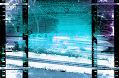 Filmstrips Urban Grunge. Blues and white grunge background is from a photograph, then layered with filmstrips border Stock Photography