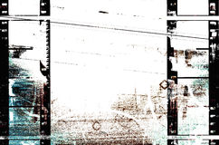 Filmstrips Urban Grunge. White, blue and brown grunge background is from a photograph, then layered with filmstrips border Stock Photography