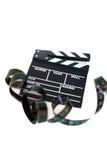Filmu clapper i 35 mm filmstrip na bielu Obrazy Stock