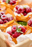 Filo cups with Mascarpone filling topped with raspberries , delicious dessert. Phyllo cups with Mascarpone filling topped with raspberries, delicious dessert royalty free stock images