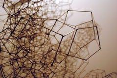 Filo di ferro tridimensionale piegato in un macro tiro Fotografie Stock Libere da Diritti