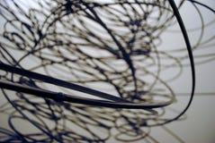 Filo di ferro tridimensionale piegato in un macro tiro Fotografia Stock Libera da Diritti