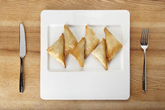 Filo pastry. On white plate with fork and knife Stock Photos