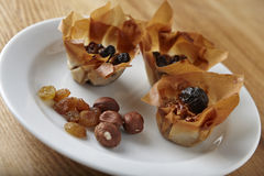 Filo pastry. On white plate with walnuts and raisins Stock Photo