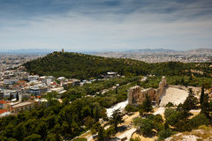 Filopappos  Hill. View of Filopappos Hill and Odeon of Herodes Atticus from Acropolis, Greece Royalty Free Stock Photography