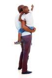 Fils africain de père Photo stock