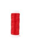 Fils de couture multicolores rouges sur le fond Photographie stock