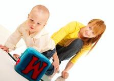 Fils et pièce et étude de mère Photo stock