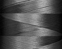 Fils gris de couleur dans la bobine, macro Image stock