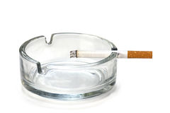 Filter cigarette in an ashtray, isolated on white Stock Photography