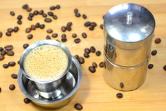 Filter Coffee. Madras filter coffee with coffee beans and coffee filter. Madras filter coffee is famous filter coffee in India royalty free stock images