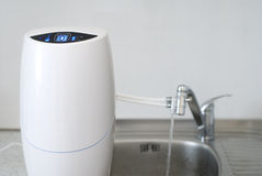 Filter connected to the tap Royalty Free Stock Image