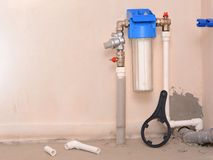 Filter system for water treatment. Installation of a reducer and a water filter for water purification. Filter system for water treatment. Installation of a Royalty Free Stock Photo