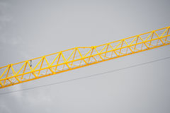 Filtered Construction crane grey sky backdrop Royalty Free Stock Image