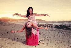 Filtered photo belly dancers on beach Royalty Free Stock Image