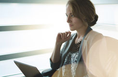 Filtered portrait of an executive business woman writing on a glass wall at sunset Royalty Free Stock Image