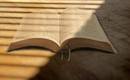Filtered sunlight on bible Stock Images