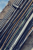 Filtered vintage bunch of data cables outside on wall Royalty Free Stock Photography