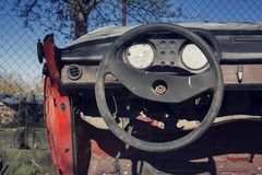 Filtered vintage photo of steering wheel and rusty speedometer on dashboard Royalty Free Stock Image