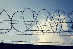 Filtered vintage picture of barbed wire fence Stock Photos