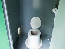 Filthy camp ground outhouse latrine inside toilet Stock Images