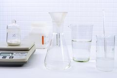 Filtration of suspension in lab Stock Photo