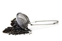 Filtro com folhas do chá Imagem de Stock