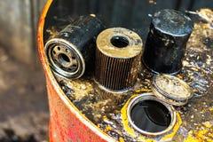 Filtros de aceite usados para la profundidad del campo baja Fotografía de archivo libre de regalías
