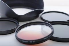 Filtros de la foto y capo motor de lente Imágenes de archivo libres de regalías