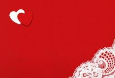 Filz-Hintergrund mit Herzen und Spitze Stockbild