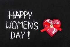 Filzhintergrund für den Tag der Frauen Lizenzfreie Stockfotos