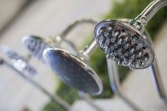 Fim acima da água do banheiro do metal e do projeto da beleza deles Fotos de Stock Royalty Free
