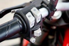 Fim acima da motocicleta grande leve da bicicleta do controle do interruptor fotos de stock royalty free