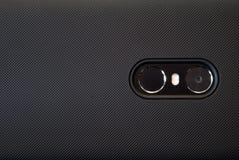 Fim acima da objetiva e da lanterna elétrica de Smartphone imagens de stock royalty free
