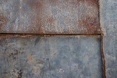 Fim acima da oxidação na superfície do ferro velho imagens de stock royalty free